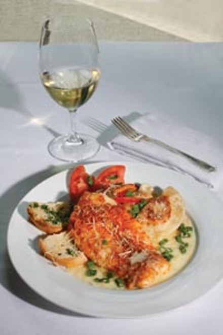 Parmasean-crusted grouper with lobster pierogies in a garlic-butter sauce - HEATHER MULL