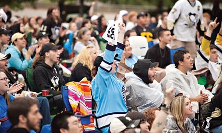 Penguins fans watch on the edge of their seats as the Penguins battle the Hurricanes in game 4 of the Stanley Cup playoffs. - BRIAN KALDORF