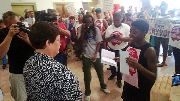 Pittsburgh City Council President Darlene Harris speaks to demonstrators about their concerns after the acquittal of George Zimmerman in the shooting death of Trayvon Martin. - PHOTO BY CHRIS POTTER