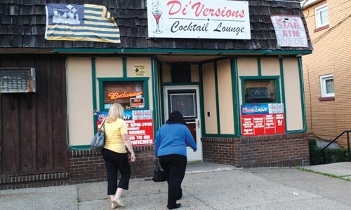 Pittsburgh City Councilor Theresa Kail-Smith and Sheraden community activist Ginny Kropf, outside Di'Versions Cocktail Lounge in Windgap, on June 1. - HEATHER MULL