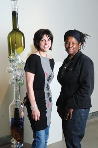 "Pittsburgh Glass Center's Community Relations Coordinator Heather Joy Puskarich and GAGI Festival Director Christine Bethea pose with Melissa Fitzgerald's ""Rainsong Seeks Water."" - HEATHER MULL"