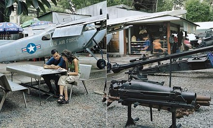 """Plane facts: Howard Henry Chen's """"Fernando and Sylvie reading the Lonely Planet at The War Remnants Museum (formerly The Museum of American War Crimes, but the People's Committee of Ho Chi Minh City changed the name sometime after Hanoi and Washington normalized relations."""""""