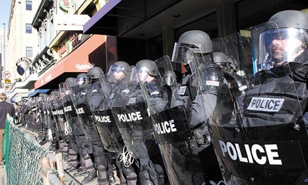 Police officers in riot gear met protesters at a 2006 anti-war march. More of the same is expected at September's G20 summit. - RENEE ROSENSTEEL