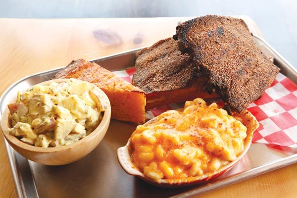 Pork ribs, mac-and-cheese, potato salad and cornbread