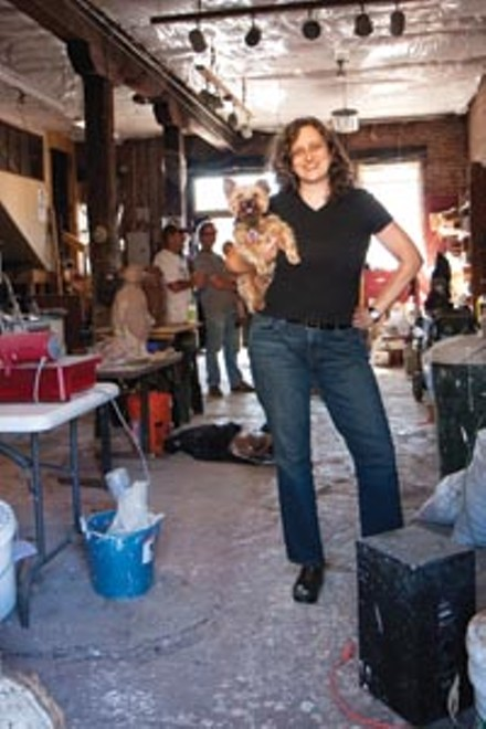 Portrait of the author with a young dog: Sherrie Flick and friend in James Simon's Uptown sculpture studio. - JOHN ALTDORFER