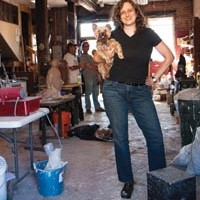Portrait of the author with a young dog: Sherrie Flick and friend in James Simon's Uptown sculpture studio.