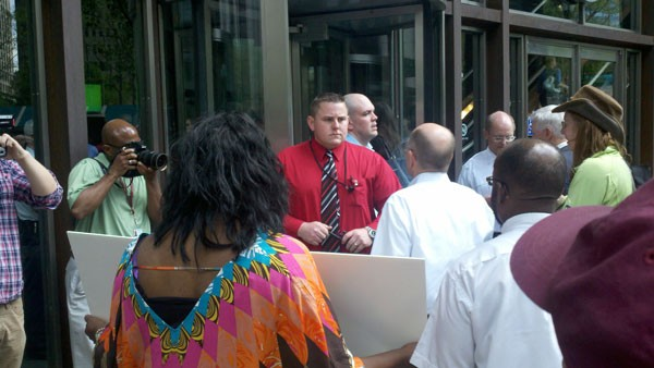 Protesters, led by Pittsburgh United's Barney Oursler, attempt to enter UPMC Tower on Grant Street Monday afternoon.