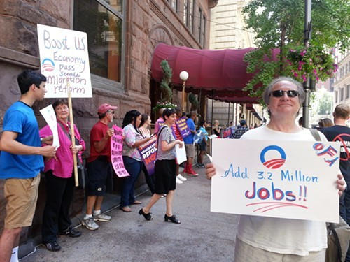 Protesters outside the Duquesne Club Downtown Monday.