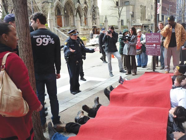 "Protesters stage a ""red-carpet protest"" for Gov. Tom Corbett on Feb. 17."