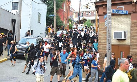 Protesters stream onto Butler Street after pepper-spray canisters are released. - CHARLIE DEITCH