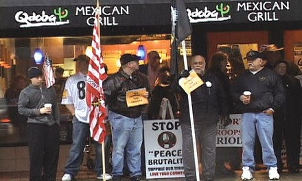 Protesting the protesters in front of the military recruitment center in Oakland