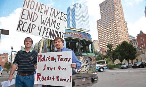 Raise taxes or cut transit; Gary English, left, and Cullen Vandora, (pictured at a recent transit protest) aren't the only two people taking sides. - JOHN ALTDORFER