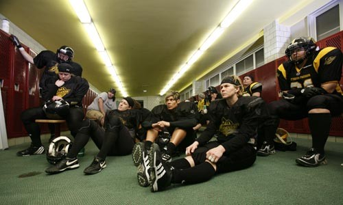 Reviewing plays in the locker room during practice. - HEATHER MULL