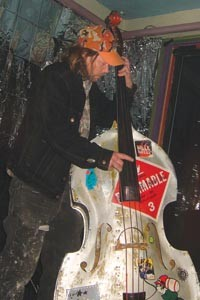 Richmond plays his aluminum standup bass at Brillobox. - COURTESY OF SARA EMILY KUNTZ