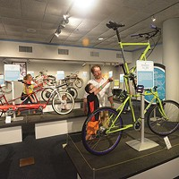 "Riding high: A ""tall bike"" display is part of <i>BIKES</i>."