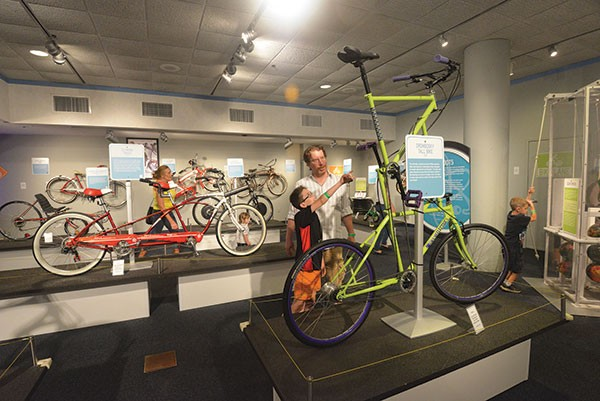 "Riding high: A ""tall bike"" display is part of BIKES."