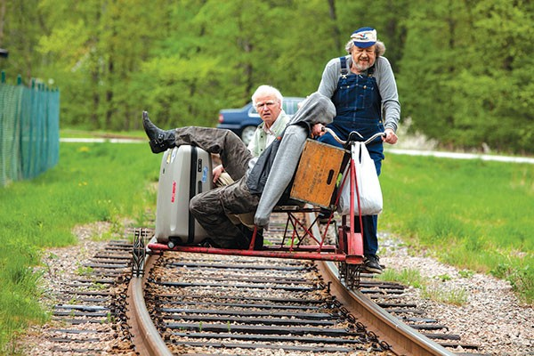 Riding the rails: Allan (Robert Gustafsson) and Julius (Iwar Wiklander) transport some recently deceased human cargo