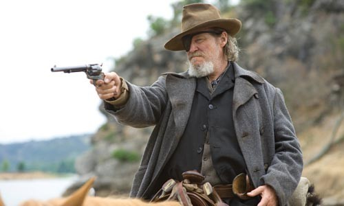 Rooster (Jeff Bridges), locked and loaded