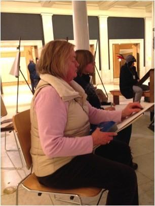 Sarah Moreno draws at the museum