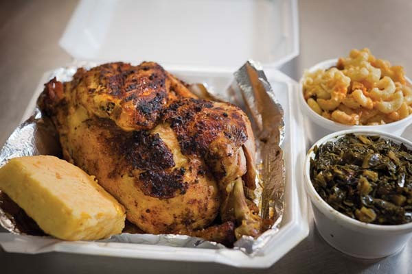 Seasoned half-chicken with cornbread, collard greens, and macaroni and cheese