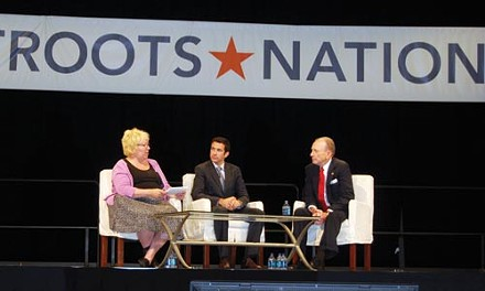 Sen. Arlen Specter, right, at Netroots Nation conference with moderators Susie Madrak and Ari Melber