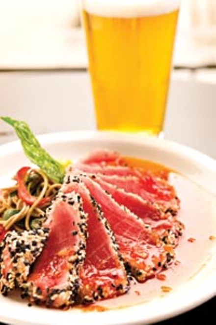 Sesame-encrusted ahi tuna served with a soba-noodle salad and sweet chili-soy sauce - BRIAN KALDORF
