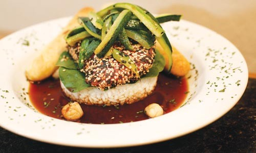 "Sesame seed-crusted Ahi tuna ""stack,"" atop risotto with zucchini and a balsamic sauce - HEATHER MULL"