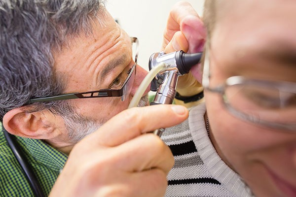 Shane Collins receives care for an ear infection from Dr. Martin Seltman. - PHOTO BY RENEE ROSENSTEEL