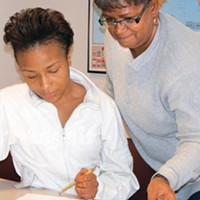 Shequaila Griffin (left) and Diane Bunch are benefiting from adult-literacy classes. But the program faces large budget cuts.