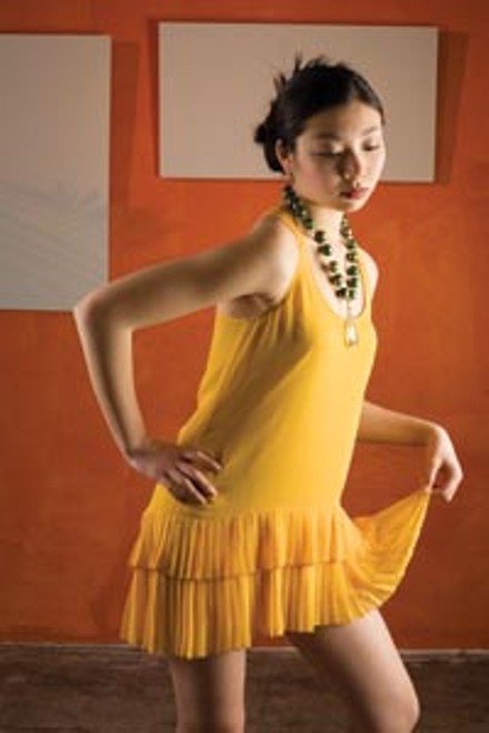 Siran wears: gold silk dress by Twelfth Street by Cynthia Vincent, available at Chick Downtown; quartz, wood and crystal necklace, by local designer Alma Lleros-Thompson for Alma Jewelry, available at Mia Boutique. - HEATHER MULL