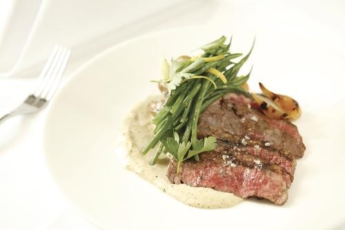 Skirt steak in ramp cream, with fingerling potatoes and pearl onions - HEATHER MULL