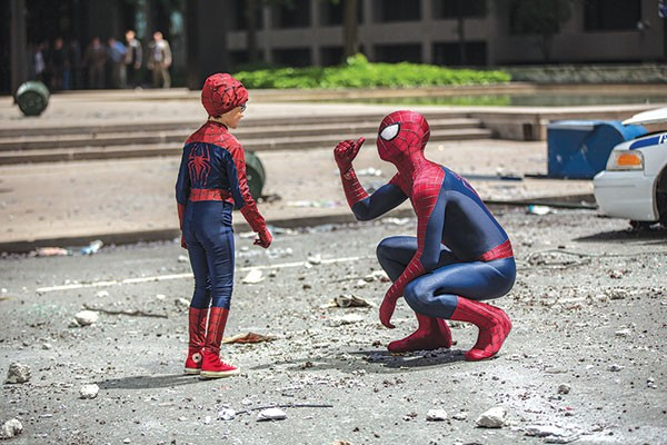 Spider-Man (right) meets a fan.
