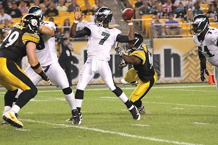 Steelers linebacker James Harrison prepares to sack Philadelphia's Michael Vick. - PHOTO BY HEATHER MULL