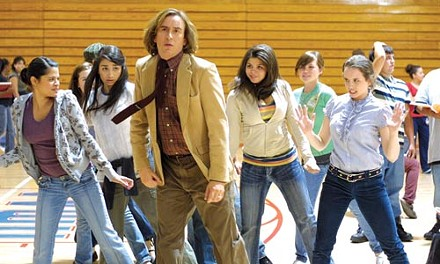 Steve Coogan (center) shakes his groove thang.