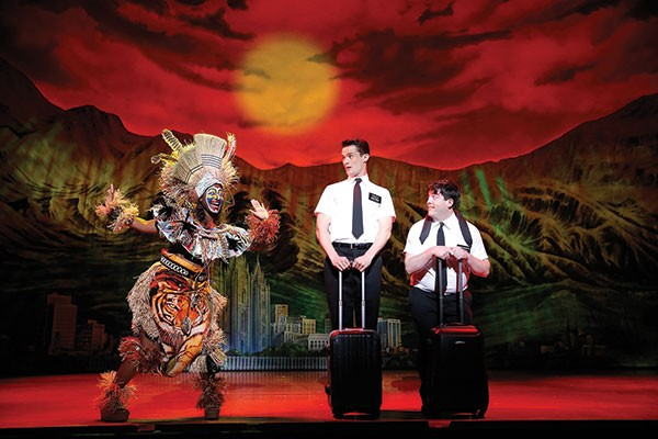 Stormin' Mormons: Mark Evans (center) and Christopher John O'Neill (right) with Phyre Hawkins in The Book of Mormon