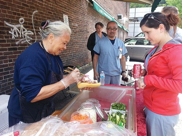 Street-food vendor Lucy Nguyen sells banh mi.