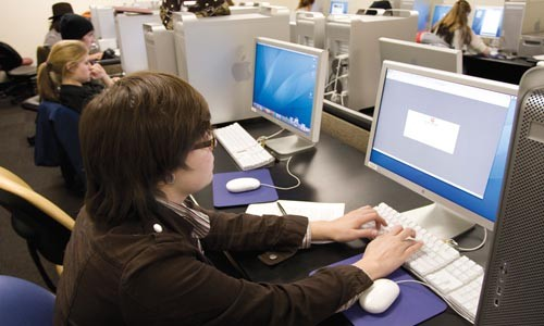 Student Brittany Seagle in one of AIP's computer labs. - BRIAN KALDORF