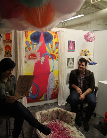 Student Jessica Aguero (left) welcomes a visitor at the 2012 Open Studio