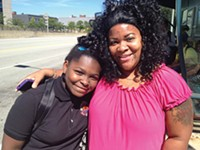 Tamara Gibson, 42, was taking her daughter, Avani, 9, to the hair salon from the Negley Station. She said she is happy with the new machines and ConnectCards. - PHOTO BY EMILY DEMARCO/PUBLICSOURCE
