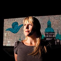 Tami Dixon in rehearsal at City Theatre for <i>South Side Stories</i>, with a projection by artist David Pohl