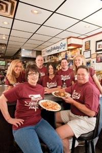 Tell em Guy sent you: Nadine's crew (from left) Kim Aul, Nadine Voelker, Earl Rudis, Peep Meade, - Matt Voelker, Marissa Voelker and Mike Voelker - RENEE ROSENSTEEL
