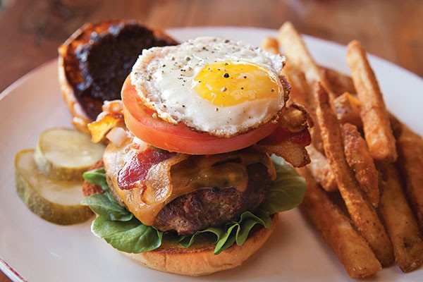 Ten Penny Burger, with watercress, red-onion jam, bacon and a sunny-side-up egg