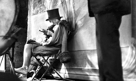 """Text message: """"Carnival, Paris (woman reading behind stage),"""" (1926), by Andr Kertsz. - COURTESY ESTATE OF ANDR KERTSZ/HIGHER PICTURES 2007."""