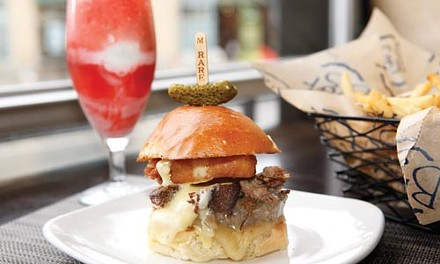 The Button Buster burger, with fries and a bourbon cherry float - HEATHER MULL
