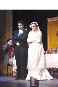 """The marrying kind: Parag S. Gohel (left) and Jennifer Murray in Pitt Rep's """"The Wedding."""" Photo by Patti Brahim."""