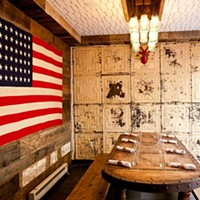 Butcher and the Rye The street level dining nook wall is decorated with reclaimed tin ceiling tiles. Photo by Heather Mull