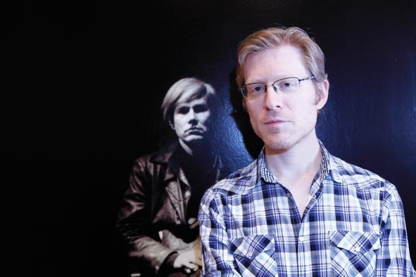 Though not yet in costume, Broadway star Anthony Rapp works on his noncommital gaze as he prepares to play Andy Warhol in POP!, a new musical at City Theatre
