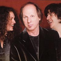Three and a perfect pair: Adrian Belew with Julie and Eric Slick