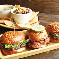 Three sliders, tortilla chips with corn-and-bean and queso dips
