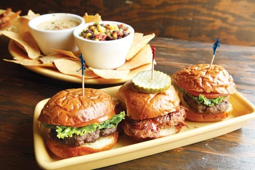Three sliders, tortilla chips with corn-and-bean and queso dips - PHOTO BY HEATHER MULL